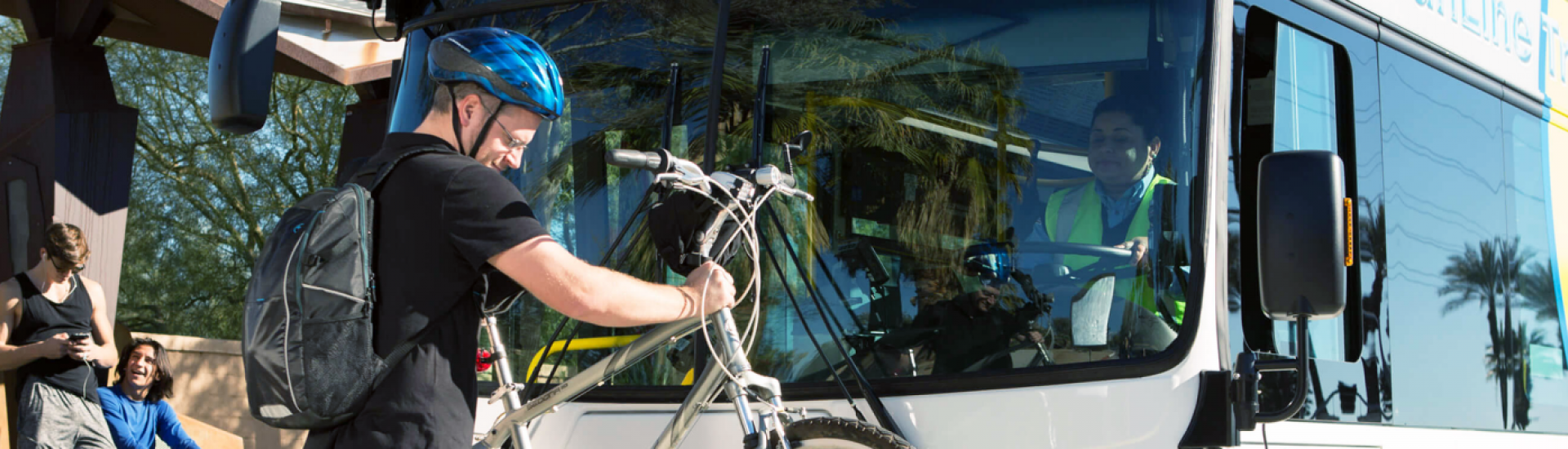 passenger loading his bike on SunLine's Bike Rack